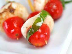 Mini Caprese Bites | Super easy finger foods are the perfect way to kick off a party. No forks or spoons are required for these easy-to-pick-up party foods, so you can clean up in no time. If you decide to throw an all-appetizer party, make sure you provide a variety of options: chips and dip, warm spreads, easy pick ups, and even one-bite salads can be combined to set out the perfect spread. You'll like these easy finger foods so much that you might even skip dessert.