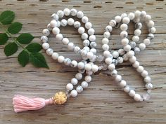 PEACEFUL PRESENCE MALA Wear this white howlite and rose quartz mala as a gentle reminder to be present.