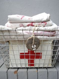 vintage linens and first aid kit in a basket. Sweet Dreams Beds, Celestine, Cross Love, Vintage Laundry, American Red Cross, Linens And Lace, Wire Baskets, Little Red, Home Decor Bedroom
