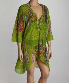 Don this darling tunic for a day spent in sheer bliss. Constructed from breathable cotton, its vibrant print and beautiful bell sleeves lend bohemian beauty to any ensemble. Size note: This item runs small. Please refer to the size chart.