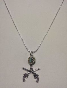 38 special bullet, swarovski crystal & pistol necklace! Check out this item in my Etsy shop https://www.etsy.com/listing/244237888/38-special-bullet-necklacegun