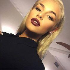 Sleek hairstyle, burgundy lipstick,radiant skin and long eyelashes for vampy makeup inspiration. #makeup #vampy #oxblood