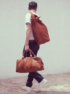 Yes, men need those too. From briefcases to bags to the perfect scarf, these subtle additions make it all come together.