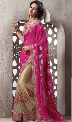 Incite your admirers to bask in your glory with this pink and beige color viscose satin net embroidered half n half sari. The stunning lace, stones and resham work a considerable feature of this attire. #pinkhalfnhalfsaree #stunningdesignsaris #weddingsarees