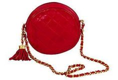 Chanel red quilted lambskin evening bag with tassel and long chain.