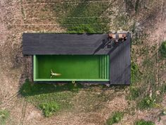 This house features a green lined swimming pool.