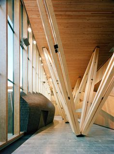 The primary goal of the construction project was to use Finnish wood in innovative ways. Hence, wood is the main material used throughout the building, from the post-beam-slab -system in the structural frame to the exterior cladding. The building fits in the cityscape in respect to its size, which is closely related to the adjoining buildings. However, the clear form and the uniform materiality achieved through the extensive use of wood make it a distinct entity.