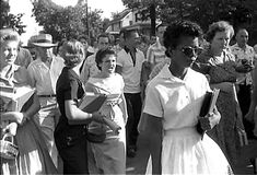 Elizabeth Eckford on her way to school in Little Rock, Arkansas September 4, 1957.  I always look at the grace Elizabeth exhibits under the onslaught of hatred in the taunting women's faces.  This picture always makes me a sad & a little queasy, but it also makes me proud of Ms. Eckford and her courage.