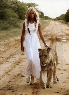 Yes I think I'll walk with a lion on my wedding day too. It seems the right thing to do.. Lol