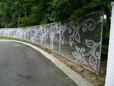 What a cool way to dress up chain link fence!