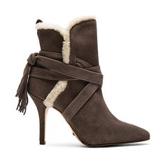 Schutz Finn Sheep Fur Bootie (£230) ❤ liked on Polyvore featuring shoes, boots, ankle booties, booties, high heel boots, tassel ankle boots, ankle strap boots, high heel ankle booties and shearling boots