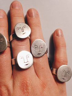 A moon face to wear day or night! Hand made in Sterling Silver.Each face has a different character and so may vary slightly from those shown in the image.......................................................All of my products are completely unique and made by hand in my Devon studio. Please allow two weeks from the time of order for items that are to be made to size.Please select your size UK (US):