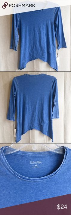 Calvin Klein Performance 3/4 Sleeve Top Brand new with tags! Calvin Klein Performance 3/4 sleeve athleisure top. Awesome cross-crossed hem line! Blue with a slightly distressed look. Cotton/poly blend. Calvin Klein Tops