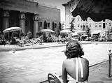 Lounging at the Ambassador Lido Club swimming pool, Ambassador Hotel ...