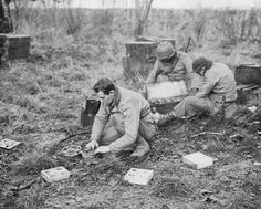 THE ARDENNES OFFENSIVE 16 DECEMBER 1944 - 28 JANUARY 1945. Men of the 28th Division HQ Company prepare mines to check the advancing German Panzers.