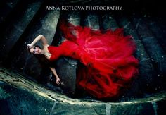 Red Dress. Dramatic setting!  Fashion/Model/ Dress Hair/MUA: Olga Chulgareva/ Anna Kotlova-Photography Model: Olga Chulgareva Dress by: Anna Kotlova Photography