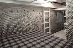 Daniel Arsham's apartment in Brooklyn - a mere 90 square feet. The apartment's a loft attached to the offices of Snarkitecture and uses 25,000 Ping Pong balls to create an amazing mosaic across its walls.