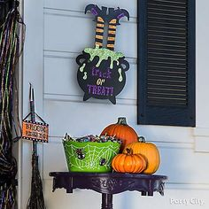 What's the best part of Halloween? Candy! Set up a Green Friendly Spider bowl, pumpkins, and a Glitter Trick-or-Treat Sign for the ultimate candy display!