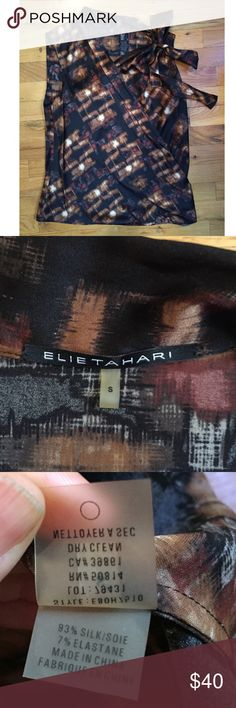 """30% OFF BUNDLES Elie Tahari Silk Blend Blouse EUC Perfect silk blouse from luxury brand Elie Tahari. This top will save the day at work or on the weekends over skinny jeans! Bust(underarm to underarm):18"""" Total Length:26"""" All measurements are taken with the item laid flat.  EUC (Excellent Used Condition) No issues! SILK blend. See photos. Black & Brown Contemporary Print 30% off on bundles.I ship same-day from pet/smoke-free home.Buy with confidence.I am a top seller with close to 500 5-star…"""