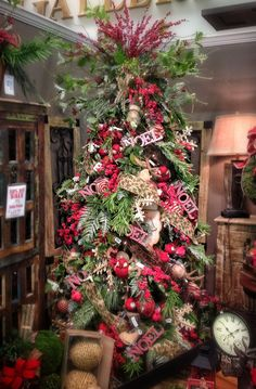 Woodsy Natural themed Christmas Tree with Burlap Ribbon and Ornaments Dashed with Wooden Snowflakes and Bright Red Berries will bring back Classic Christmas Cheer to your Decorations this year!