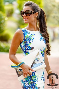 Blue floral pattern on the sides of this white dress for a ladylike take for this summer