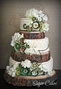 rustic wedding cake using real wood cake bases - postscripts.etsy.com - cake by sweet cakes
