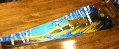 Hand painted saw blade by Charlene Deleel. Follow on etsy at etsy.com/shop/TreasuredMountain