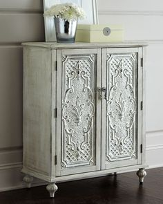 "Filippi Chest at Horchow.  Ornately detailed door panels and a distressed finish give this cabinet vintage appeal. Two shelves provide storage on the interior. Made of birch. Hand-painted finish. Two doors and two shelves. 34""W x 15""D x 41""T."