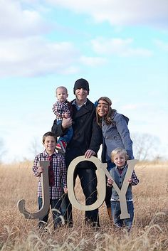Each of our married kids can have their family photo taken holding letters that spell out joy, peace, hope, etc.  Then place each family photo on the same Christmas card.