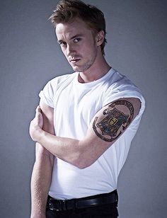 Tom Felton - I know it's photoshopped in - but check out his super cool Hogwarts Tattoo!  Hogwarts forever!!!