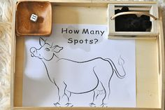 How Many Spots? Roll the die and spot the cow.