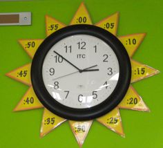 "Sun Clock--nice idea. We have analog clocks @ 3 places in the house to help work this concept into the kids' minds,  but they still keep looking to digital clocks to tell time. I think the bright graphic on this will make the clock face more attractive. Good move! Will make sun in ""school room,"" maybe other things in other rooms (thinking race cars going around a track in toy room...)"