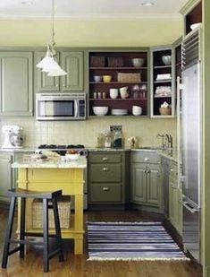 Character to a Small Kitchen Paint back of open cabinets an accent color. Kitchen Decorating: Add Character to a Small KitchenPaint back of open cabinets an accent color. Kitchen Decorating: Add Character to a Small Kitchen Green Kitchen Cabinets, Brown Cabinets, Open Cabinets, Kitchen Cabinet Hardware, Painting Kitchen Cabinets, Kitchen Cabinet Design, Kitchen Paint, Kitchen Interior, New Kitchen