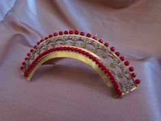 Mistress of Disguise: A Regency Coral Diadem, her site also has a tutorial about making these diadem / tiaras.