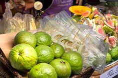 Thai guava can be eaten ripe or, more popularly, unripe. Street vendors will serve you slices in plastic bags. You'll get to shake the seasonings on them to enjoy. Read more.