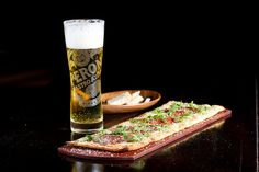 Pepperoni & Arugula Flatbread with an ice cold Peroni. Come in Monday thru Friday from 3-6pm for a special price at select locations!