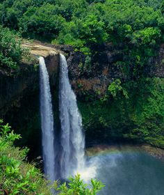 Kauai, Hawaii. Who wouldn't want to stand under that waterfall and next to that rainbow??