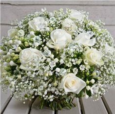 Million Star Gypsophila as a foliage with grouped crisp white Avalanche Roses with groups of white Bouvardia