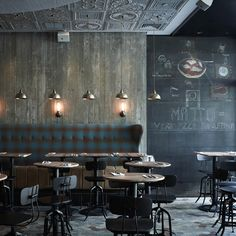 Matto Bar, Shanghai // Pure Creative International  Clad in wood, the main area has something of the frontier town about it. Vintage effect wall lighting contributes to the old-time charm, while overhead, Victorian cornices disguise the air-con housings...
