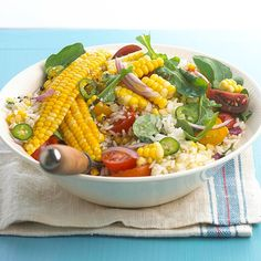 Fresh Corn-Rice Salad.  Filled with fresh corn, cold rice, juicy tomatoes, and fresh arugula, this light and fresh salad makes the ideal hot-weather supper. Slivers of jalapeno pepper and red onion add punch