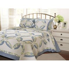The Francesca quilt set by Greenland Home updates the classic double wedding ring pattern. Vivid blues, greens and yellows combine with ivory in a contemporary spin on a time-honored patchwork style.