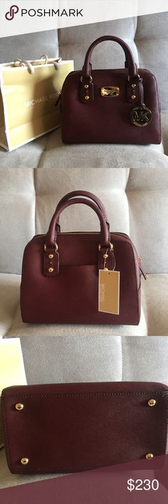 """Michael Kors Saffiano Small Satchel in Merlot Brand New! Comes with tags, adjustable/removable shoulder strap, MK shopping bag, care booklet. Gold hardware. Measures 10x8x6(at base). This color is nowhere to be found in this exact bag. Retired color """"Merlot"""" is the perfect blend of brick red and a deep purple. It is also the color of my entire wardrobe at the moment🙊. Offers welcome. Happy New Year! Michael Kors Bags"""
