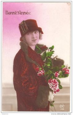 """POSTCARD """"Girl in a hat with a bouquet of roses"""" France 1930."""