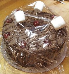Tip - put marshmallows on toothpicks to keep plastic wrap from sticking to the top of a decorated cake