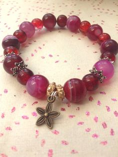 Pink purple and red glass beaded handmade by HarxieXbracelets