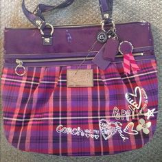 Coach Purse Poppy by Coach wasn't used for more than a month. Lots of pockets and zippers in perfect condition no signs of ware. 100% authentic care card included Coach Bags Shoulder Bags
