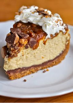 ~~Caramel Toffee Crunch Cheesecake | Better than the Cheesecake Factory! A graham cracker and toffee crust, then a smooth caramel cheesecake with homemade gooey caramel on top mixed with MORE crunchy toffee and then some whipped cream. Heavenly! | Yammie's Noshery~~