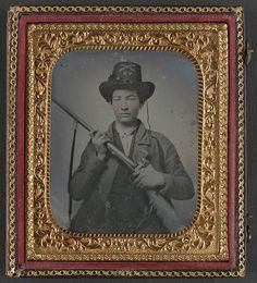 [Unidentified cavalry soldier in Confederate uniform and Valley Rangers, 10th Virginia Infantry Regiment hat, with double barrel shotgun]