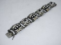 """VINTAGE GEORG JENSEN BRACELET # 32. STERLING SILVER. DESIGN BY KRISTIAN- MOEHL-HANSEN $1,900.00  Condition: fine vintage, preowned Year: after 1945  Size: about 7 1/2"""" long, and 1 1/8"""" width"""