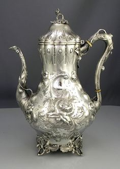 finely chased coin silver tea and coffee set with a mark of Eoff and Shepard of New York, circa 1859 and retailed by Ball Black